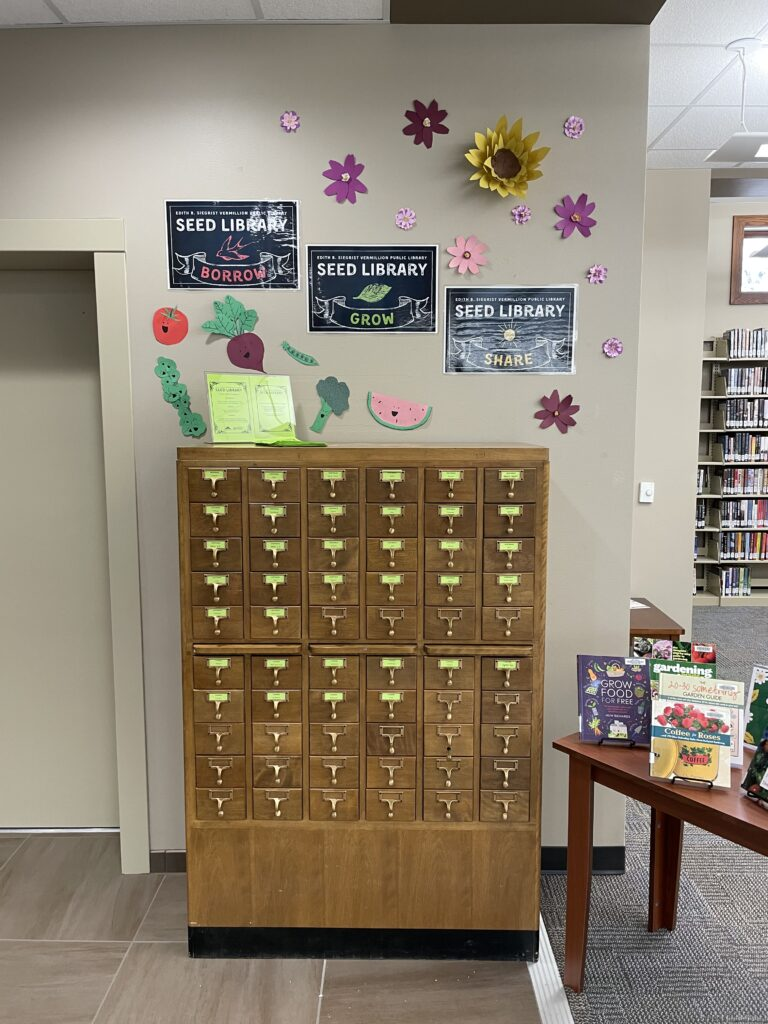 Picture of card catalog being repurposed as a seed library.